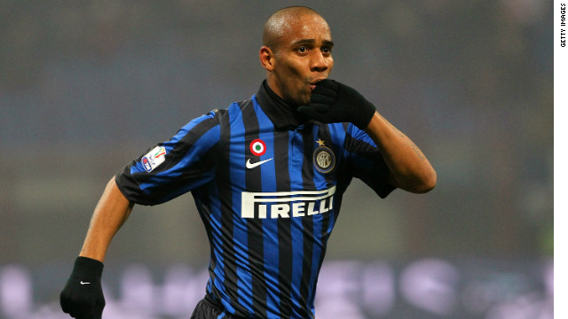 Maicon celebrates scoring Inter's opening goal in their 2-1 Italian Cup win over Genoa.