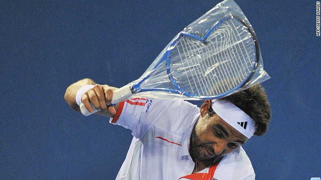 Marcos Baghdatis smashes a new racket during an outburst at the Australian Open.