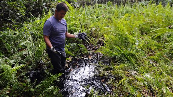 Donald Moncayo, Ecuadorean activist of the Amazonia Defense Front,  shows oil waste near La Primavera in February 2011.