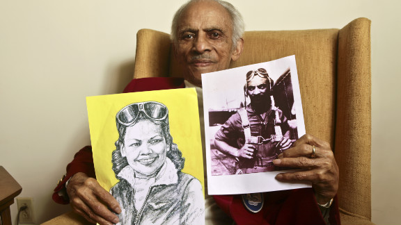 Carter holds a portrait of his wife and a photograph of himself from their flying days.