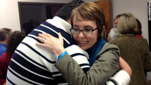 On her last day in office, Rep. Gabrielle Giffords hugs Daniel Hernandez, the former intern who saved her life.