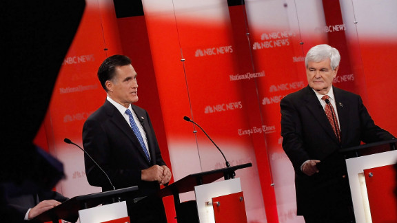 Mitt Romney and Newt Gingrich debate in Tampa, Florida, on Monday night.