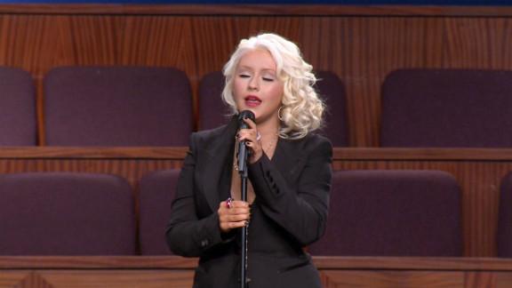 "Christina Aguilera sings Etta James' signature song ""At Last"" Saturday at the funeral in Gardena, California."