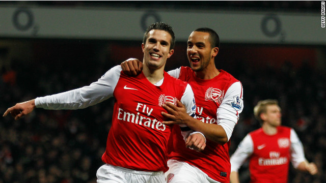 Arsenal's second half goalscorers Robin van Persie and Theo Walcott celebrate their team's second half revival.