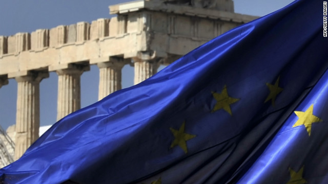 Columns of the Parthenon temple are seen behind an EU flag in Athens on November 4, 2011.