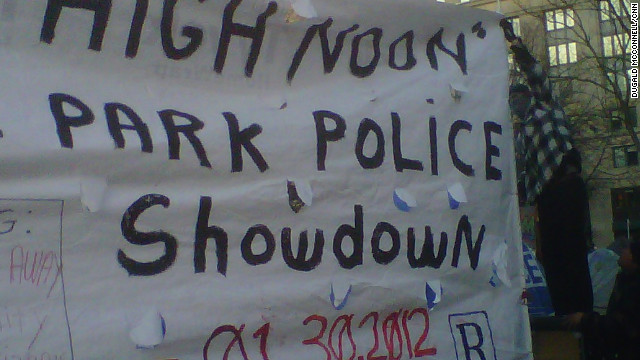 Occupy DC demonstrators displayed this sign at McPherson Square on Monday.