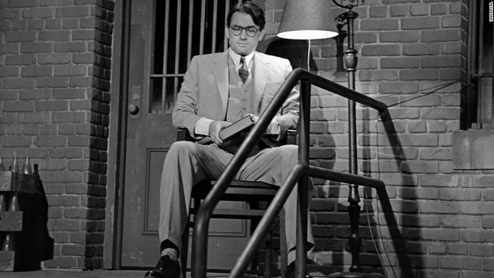 Atticus Finch sits outside the jailhouse to protect Tom Robinson.