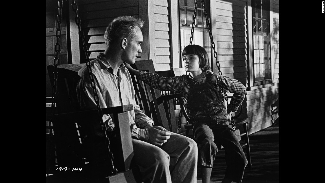 Robert Duvall as Boo Radley on the porch swing with Scout.