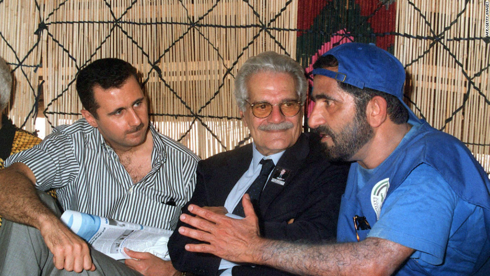 United Arab Emirates Defense Minister Mohamad ibn Rashid al-Maktoum, right, chats with Egyptian actor Omar Sharif, center, and Bashar al-Assad in a tent near Damascus in May 1999.