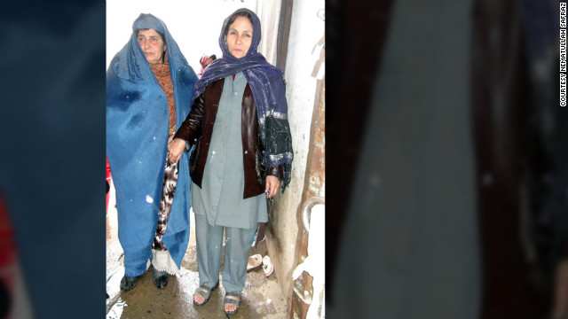 Wali Hazrata, left, is detained at the city jail in Kunduz, Afghanistan.  She is accused of helping her son, Sher Mohammed, 29, kill his wife for not bearing him any sons.
