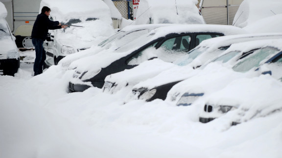A man clears snow off a vehicle in Sofia on January 27.