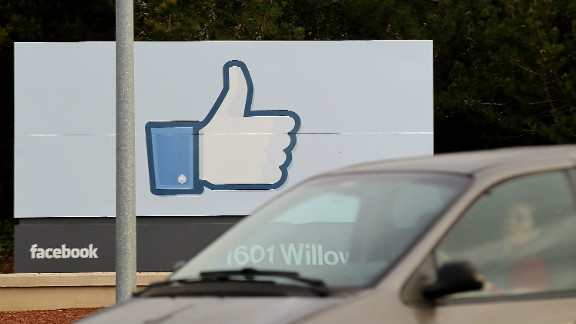 """A sign displays the Facebook """"like"""" symbol at the site's headquarters in Menlo Park, California."""