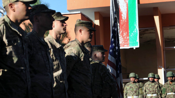 U.S. soldiers, left, at a ceremony in December to hand over security control of the city of Charikar to the Afghan authorities.