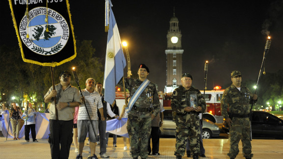 Argentinian war veterans and relatives march with torches in Buenos Aires during the 28th anniversary of the 1982 conflict.