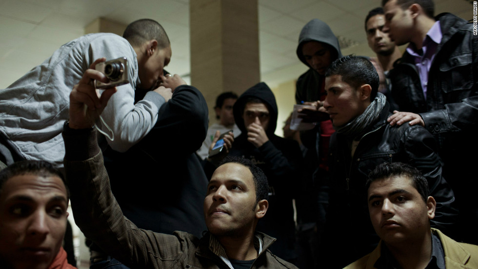 Family members and mourners gather at Cairo's railway station as they receive the bodies of football fans killed during clashes between rival fans in Port Said.
