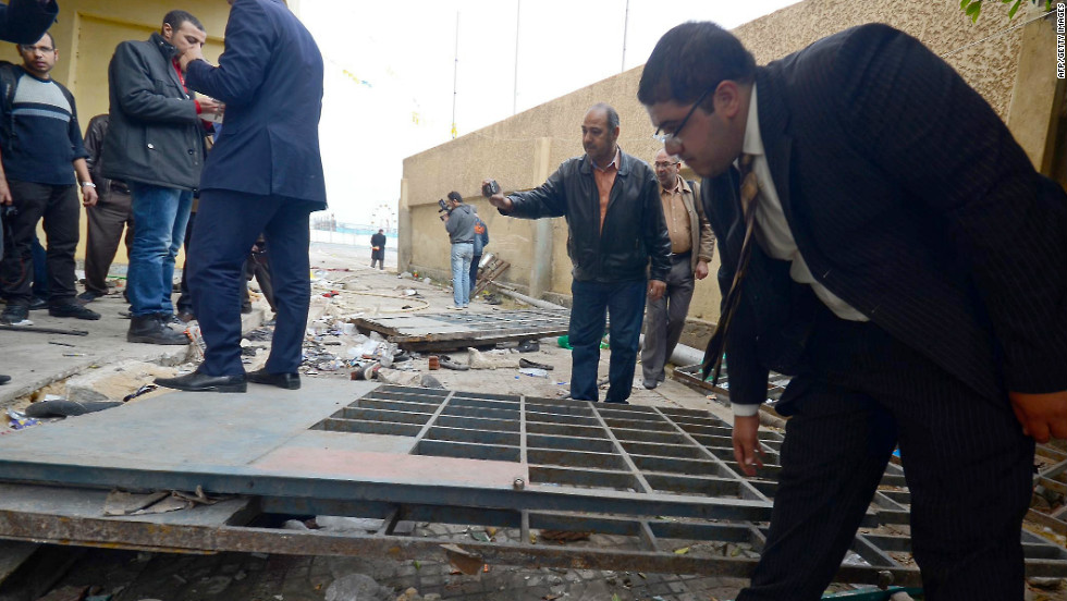 Egyptian investigators inspect damage at the football stadium in Port Said on Thursday.