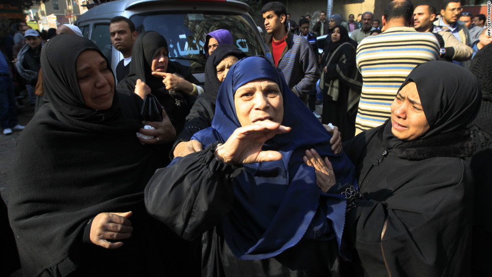 Egyptian women mourn victims of the riot at a morgue in Cairo on February 2.