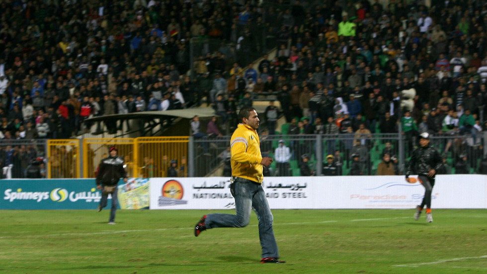 An Al-Masry fan invades the pitch during the match in Port Said.