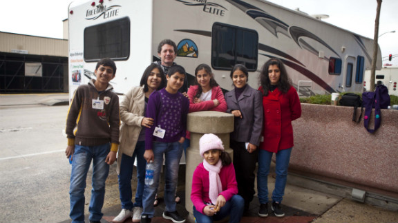 Kids from an orphanage in  Afghanistan pose in front of an RV in Atlanta. They have started a road trip from Massachusetts to California and places in between. The kids are among an estimated 2 million children living without parents in Afghanistan. Each has a special story.