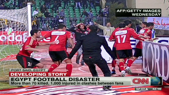 Dozens left dead as rival fans clash