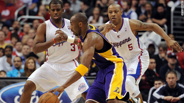 The L.A. Lakers' Kobe Bryant drives against fellow NBA All-Star Chris Paul (left) and Caron Butler of the L.A. Clippers.