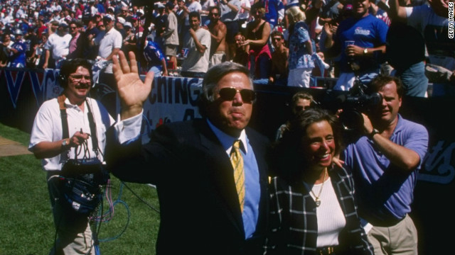 Robert Kraft and his wife Myra wave to the crowd during warmups before a 1995 Patriots game.