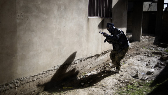 A member of the Free Syrian Army engages in an attack against the Syrian army in Al-Qusayr on January 27. The small town in western Syria has been under siege since early November.
