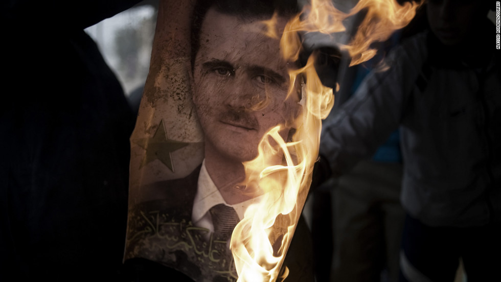 Syrians burn a portrait of President Bashar al-Assad in Al-Qusayr. The Syrian regime has faced international pressure to stop its crackdown on protesters. Some have asked for al-Assad to step down.