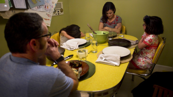 Each night at dinner, daughters Ella, left, and Rosa, right, recite prayers for Brooks and her Jewish husband, David Kamper. Sometimes the girls are inspired by their Mormonism; other times by their Judaism.