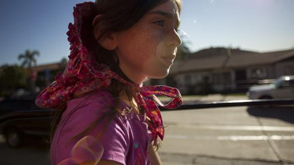 Ella, 8, wears her mother