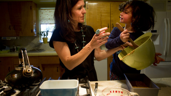 Rosa helps out in the kitchen, stirring the ingredients for pancakes. When her daughters are old enough, Brooks says, they will choose the religious path they want to walk. She