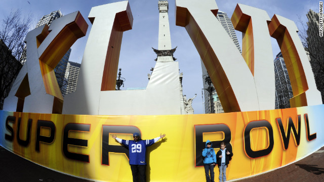 Fans pose for photos around Super Bowl Village in downtown Indianapolis before the start of Super Bowl XLVI.