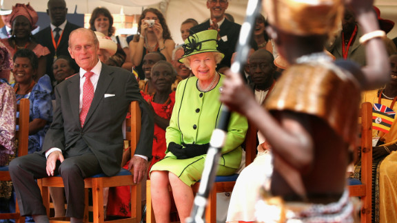 Prince Philip Queen Elizabeth II watch AIDS orphans perform a fashion show at the Mildmay centre for AIDS Orphans on November 22, 2007 in Kampala, Uganda.