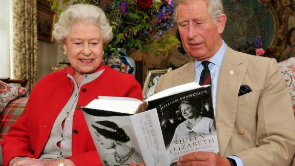 September 2, 2009: Queen Elizabeth II sits with the Prince Charles, and studies one of the first copies of