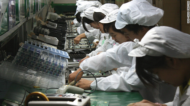 Foxconn employees work on a production line in China making electronic goods including Apple's iPad.