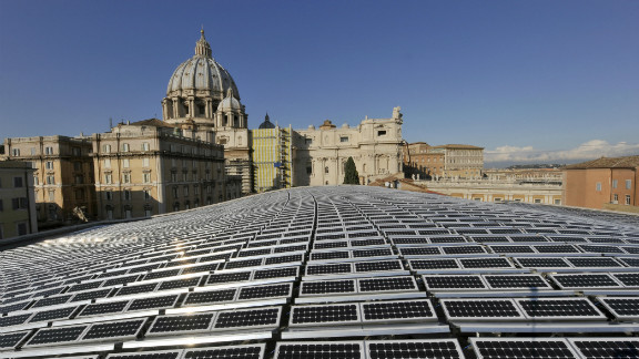 Solar panels shimmer in the sunlight in front of St Peter