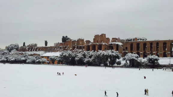 """iReporter John Pe shot this photo of the streets of Rome blanketed by heavy snowfall. He said local residents have """"gotten their snow gear and have taken to the slopes!"""""""
