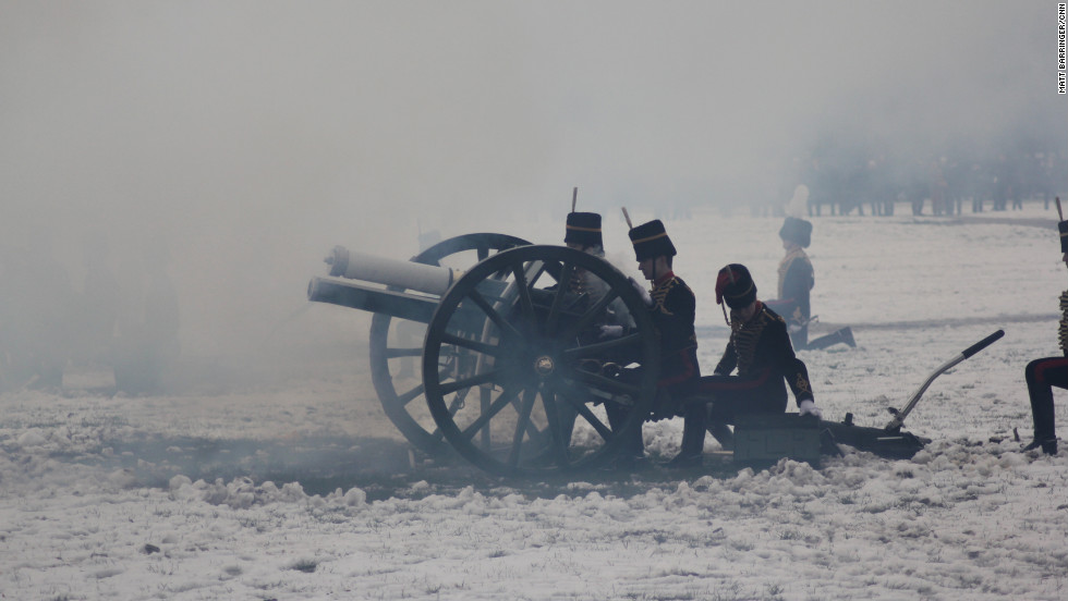 Through thick cannon mist, the gunners prepare to reload as the salute continues.