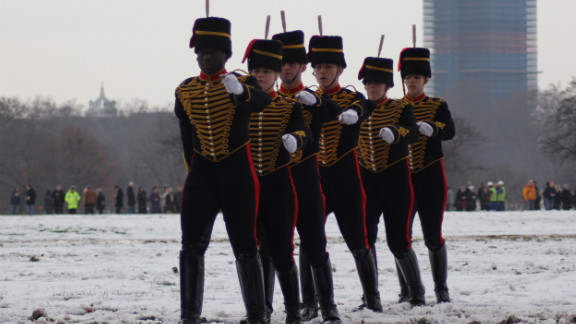 With their army-issue black boots protecting them from the melting snow underfoot, members of the King