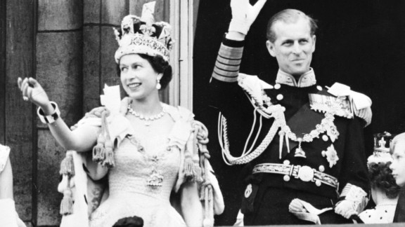 Queen Elizabeth II and Prince Philip wave to the crowd from Buckingham Palace on June 2, 1953.