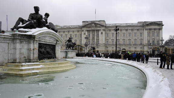 A frozen fountain stands in front of Buckingham Palace in London on Sunday. Heavy snow fell overnight across southeast England, causing many roads to become blocked.