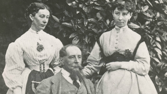 Dickens with his daughters Mary and Kate in the garden at Gad