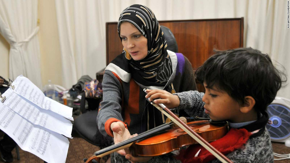 Violin teacher Elena Radwan teaching a young boy