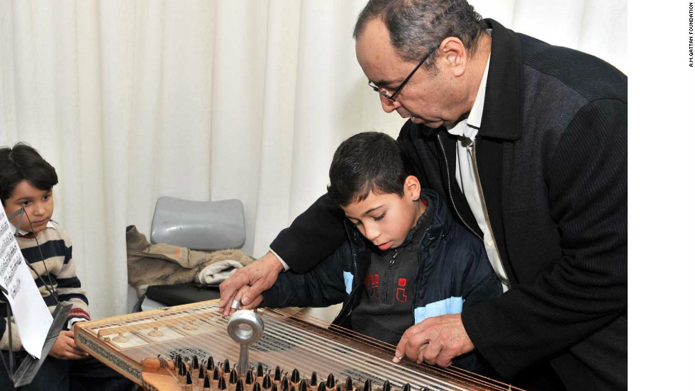 Gaza Music School Academic Co-ordinator Ibrahim Najjar teaches the Arabic instrument kanun