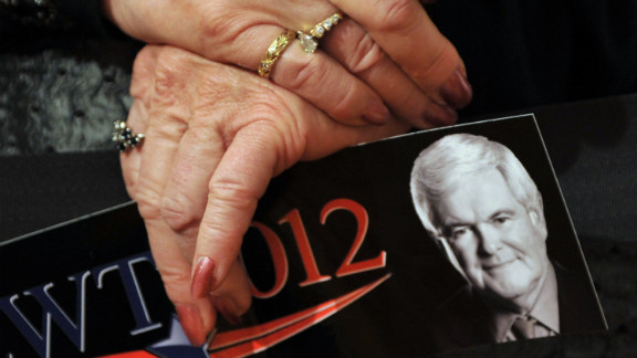 A Gingrich supporter attends a rally on the eve of Tuesday
