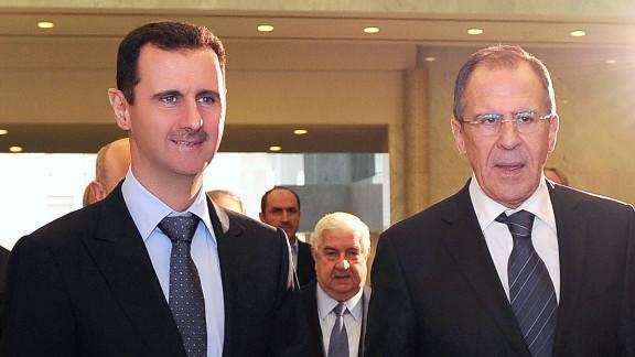 Bashar al-Assad (L) and Russian FM Sergei Lavrov in Damascus for talks on February 7.