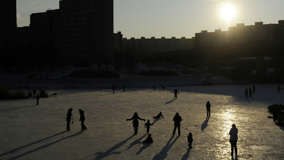 People skate on a frozen pond in Prague on February 6, 2012. Meteorologists this morning measured minus 39.4 degrees Celsius, the coldest temperature of this winter, in Kvilda village, in the South Bohemian Sumava mountains.