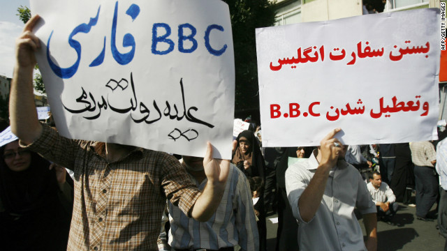 Supporters of Iranian President Mahmoud Ahmadinejad hold up placards with slogans against the British media in June 2009.