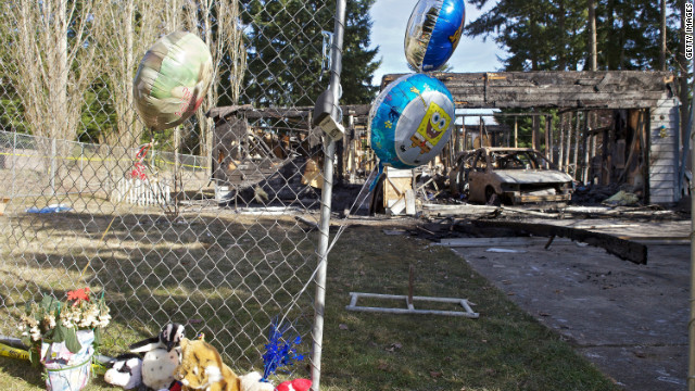 Balloons have been left  in front of the charred home of Josh Powell on Tuesday near Graham, Washington.