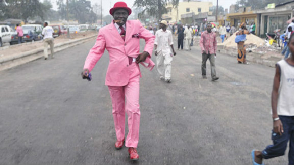 Smart suits in pastel colors are a trademark of the Brazzaville Sapeurs.